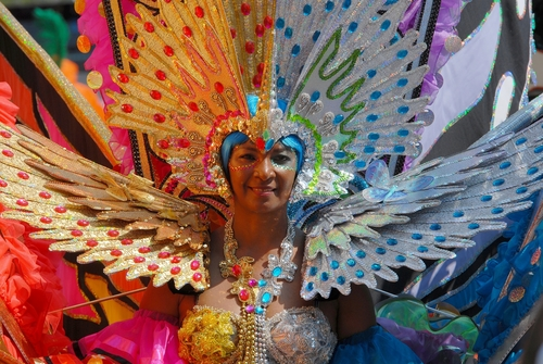 A woman participates in a Caribbean carnival. An article in the Trinidad Guardian examines calypso music in Trinidad and Tobago. (Shutterstock*)