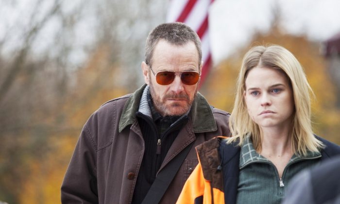 """Bryan Cranston as Topo and Alice Eve as Chloe in """"Cold Comes the Night."""" (Sony Pictures)"""