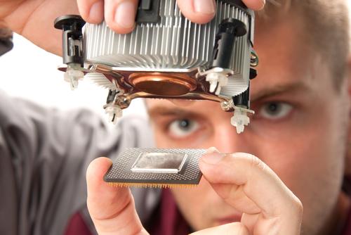 A computer engineer installs a processor. (Shutterstock*)