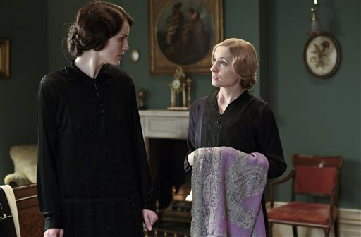 """This photo released by PBS and Carnival Film and Television Limited shows, from left, Michelle Dockery as Lady Mary, and Joanne Froggatt as Anna Bates, in a scene from season four of the Masterpiece TV series, """"Downton Abbey."""" (AP Photo/PBS/Masterpiece, Nick Briggs)"""