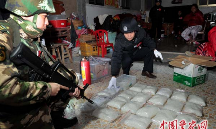 A screenshot from China Police Daily shows that armed police seize illegal drugs in Boshe village of Lufeng City in Guangdong Province on Dec. 29. (Screenshot/cpd.com.cn)