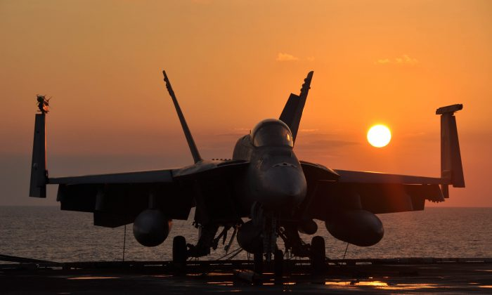 A U.S. Navy F/A-18E Super Hornet aircraft assigned to Strike Fighter Squadron 14 sits tied-down on the flight deck of the aircraft carrier USS Nimitz (CVN 68) while underway in the North Arabian Sea on Dec. 18, 2009.  The Nimitz Carrier Strike Group is on deployment to the U.S. 5th Fleet area of operations.  DoD photo by Petty Officer 1st Class David Mercil, U.S. Navy.  (DOD.gov)