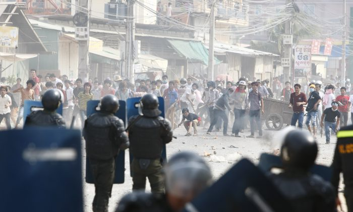 Cambodian garment workers fight with police in protests that saw four killed. (AP Photo/Heng Sinith)
