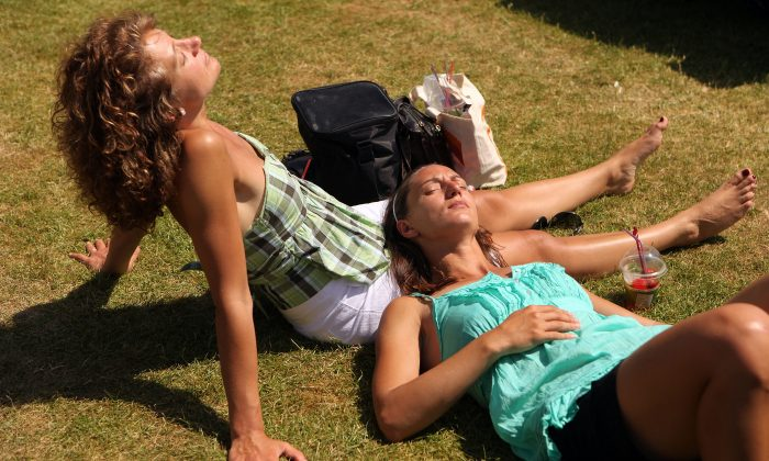 Spectators sunbathe at Wimbledon Lawn Tennis Championships on June 28th, 2010, in London. New research finds that exposure to sunlight lowers blood pressure. (Oli Scarff/Getty Images)