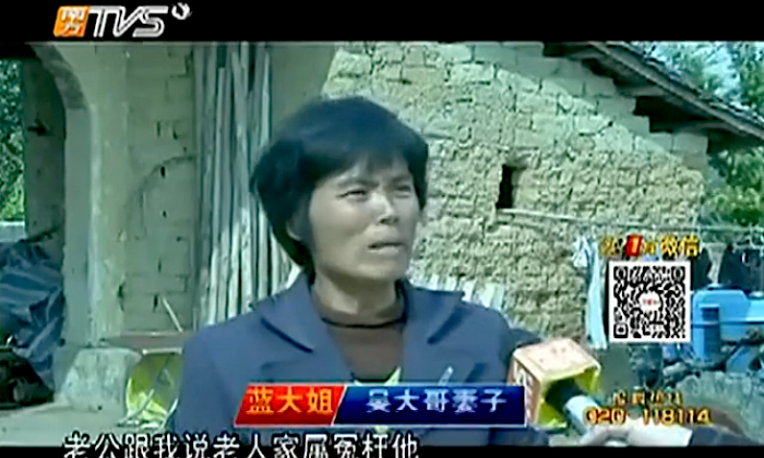 A screenshot of an official Chinese report shows the wife of Mr. Wu telling reporters that her husband was wronged by the elderly man's family. Wu, who helped a senior to hospital after a fall, said he was wrongly accused, and committed suicide to prove his point. The family of the elderly man had called Wu demanding compensation for the man's injuries. (Screenshot/TVS/Epoch Times)