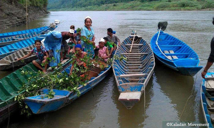 Local Burmese residents on their boats in the Kaladan River. Local people depend on the Kaladan River for transportation. (Kaladan Movement)