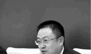 Chinese Officials Struggle to Conceal Embezzled Funds