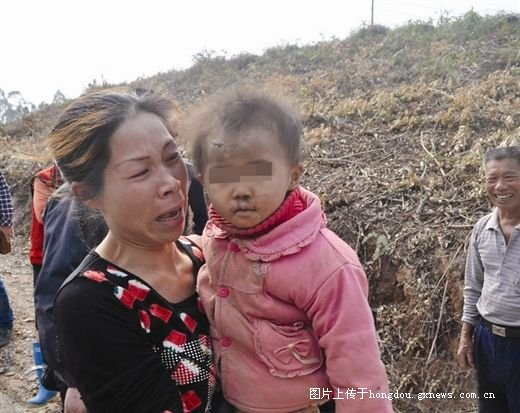 The 16-month-old girl, Mei, and her mother. Mei went missing in the mountains in Guangxi Province was found two days later in perfect health. (Screenshot/Guangxi News)