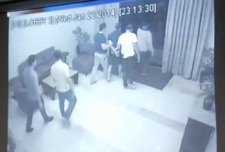 Vhong Navarro is led out of Deniece Cornejo's condo building by a group of men in a screenshot of CCTV footage from the building that. (YouTube/Philippine Inquirer)
