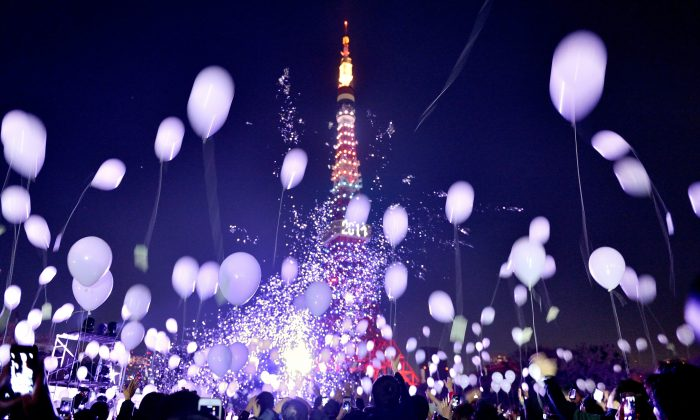New Year's Eve revelers release balloons to celebrate the arrival of 2014 near The Prince Park Tower Tokyo Hotel, Japan, Jan. 1, 2014. (Kazuhiro Nogi/AFP/Getty Images)