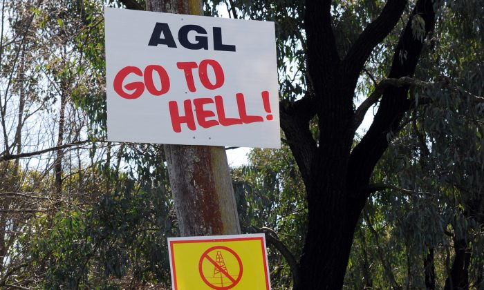 Anti-mining signs adorn a pole beside the main road through Broke, in the Hunter Valley. The NSW Government has introduced reforms to protect 5.3 million hectares of farmland and residential areas from coal seam gas mining. (Torsten Blackwood/AFP/Getty Images)