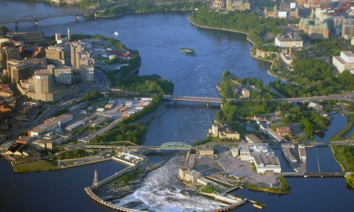 An aerial view of the Chaudière Falls in June 2006. For much of his life, famed Algonquin elder William Commanda called for the falls to be the restored to their natural state. Now, with the falls slated for further development, an Ottawa man has taken up Commanda's call. (Wikipedia/Creative Commons)