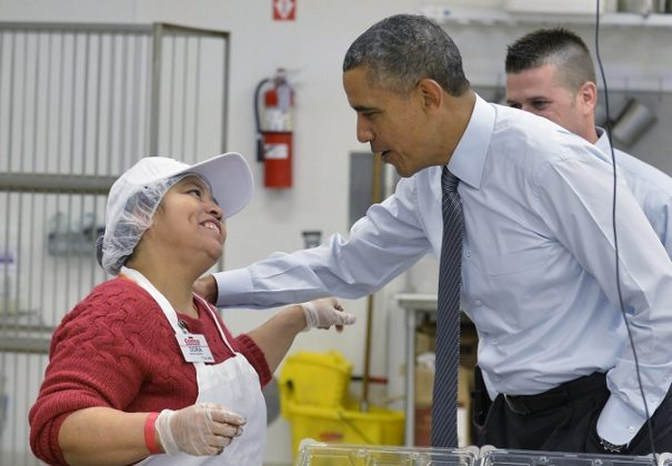 President Barack Obama (R) greets a Costco bakery employee during a tour of the store in Lanham, Maryland January 29, 2014. Obama is beginning a two-day, four-state tour to promote policies outlined in his State of the Union speech including raising the minimum wage. (Mike Theiler/Getty Images)