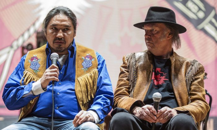 "Athabasca Chipewyan Chief Allan Adam speaks beside singer Neil Young at a press conference for the ""Honour the Treaties"" tour, a series benefit concerts being held to raise money for legal fight against the expansion of the Athabasca oilsands in northern Alberta and other similar projects, in Toronto on Jan. 12. Two energy company CEOs say Canadians are being misled by celebrities' comments deriding the oilsands. (The Canadian Press/Mark Blinch)"