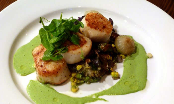 Grilled scallops, blue potatoes, stewed mushrooms, roasted corn, in an arugula reduction. (Courtesy of Manos Angelakis)