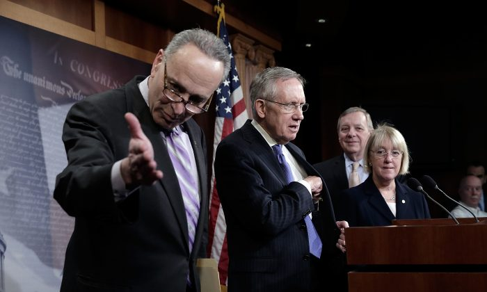 (L–R) U.S. Sens. Chuck Schumer (D-N.Y.), Majority Leader Harry Reid (D-Nev.), Dick Durbin (D-Ill.), and Patty Murray (D-Wash.) arrive at a press conference at the U.S. Capitol in Washington, D.C., Jan. 16, 2014. They spoke on pending legislation to extend unemployment insurance. (Win McNamee/Getty Images)