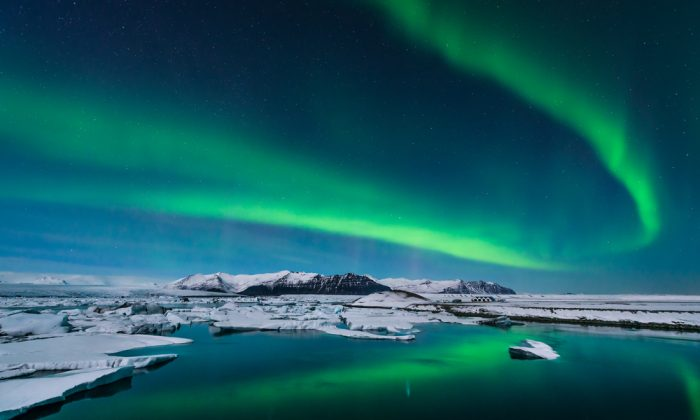 The Northern Lights dance over the glacier lagoon in Iceland. (*Shutterstock)
