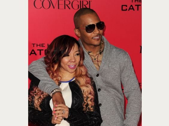 "Singer/songwriter Tiny and rapper T.I. at the Los Angeles premiere of ""The Hunger Games: Catching Fire"" in November 2013. The pair are not breaking up, T.I. said. (Robyn Beck/AFP/Getty Images)"