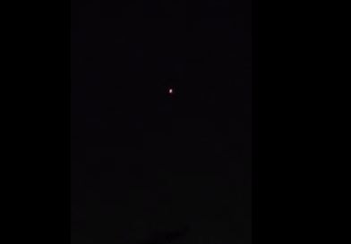 One of the described unidentified flying objects, over the Hollywood Hills in Los Angeles, California, on New Year's Eve. (YouTube/Mark McCabe)