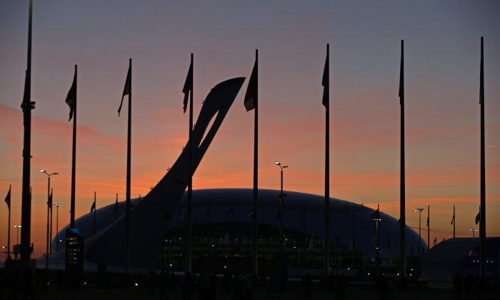 The Olympic caldron is seen as the sun sets before the opening ceremony of the 2014 Winter Olympics in Sochi, Russia, Friday, Feb. 7, 2014. (AP Photo/Darron Cummings)
