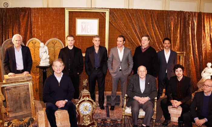 (L-R) Writer Robert M. Edsel, actors Bill Murray, Matt Damon, George Clooney, Jean Dujardin, 'Real Monument Man' Harry Hettlinger, actor John Goodman, producer Grant Heslov, actors Dimitri Leonidas and Bob Balaban attend the 'Monuments Men': Photocall at Hotel Le Bristol on Feb. 12, 2014, in Paris, France. (Julien M. Hekimian/Getty Images)