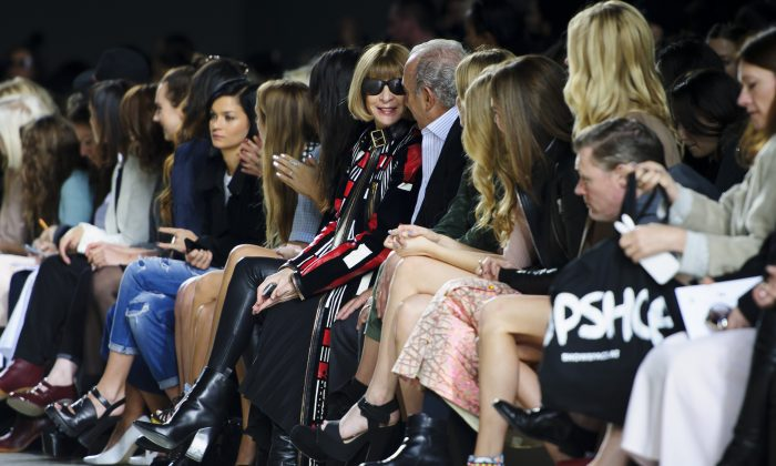 British Editor-in-chief of American Vogue Anna Wintour in the front row during the Topshop Unique collection at London Fashion Week Autumn/Winter, Feb. 16, 2014. (Jonathan Short/Invision/AP)