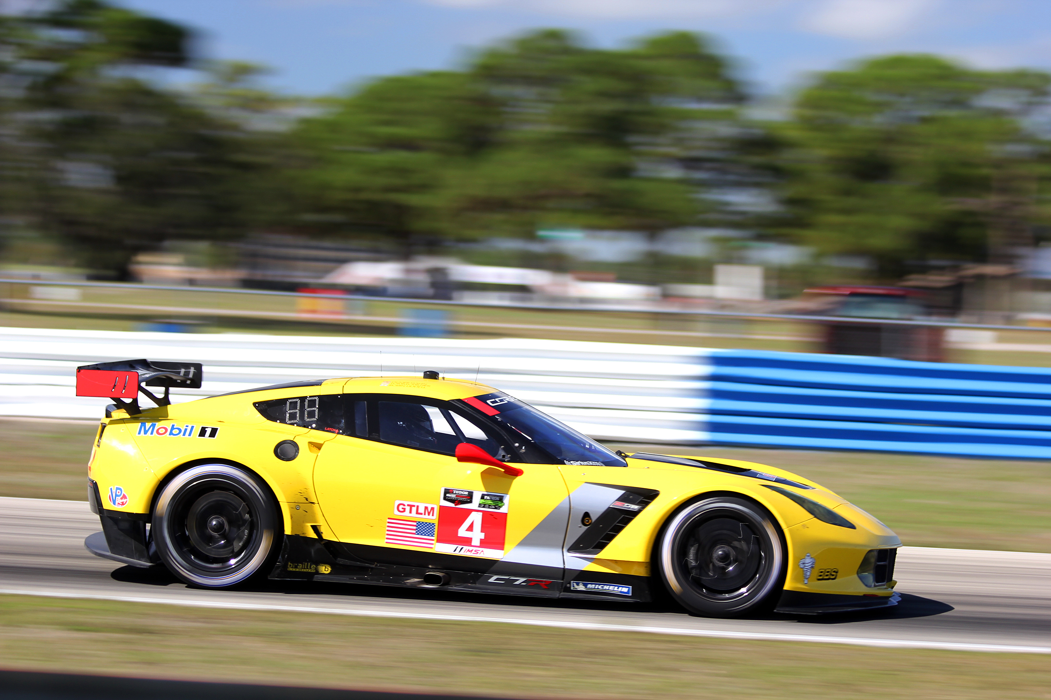 The #4 Corvette Racing C7. R heads for Turn Three Thursday morning. (Chris Jasurek/Epoch Times)