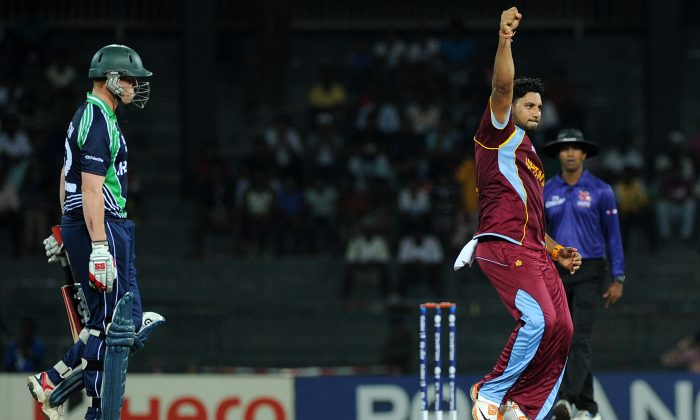 Ireland cricketer Kevin O'Brien (L) is bowled out by West Indies cricketer Ravi Rampaul in a 2012 file photo. (AFP/Getty Images)