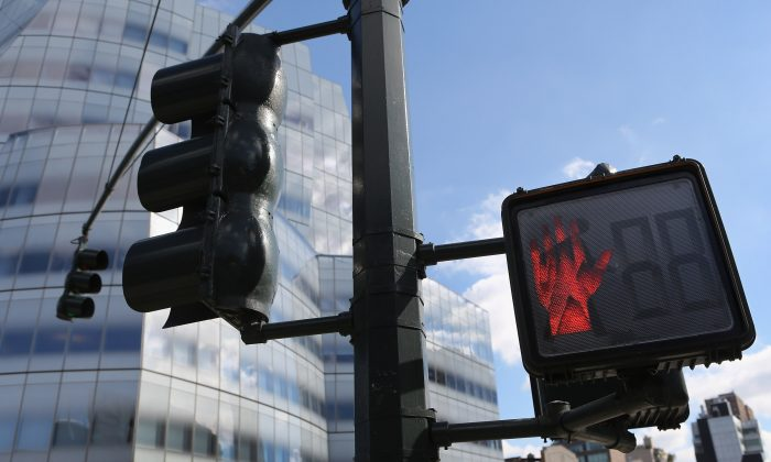A pedestrian traffic light in New York City, Oct. 18, 2012. The city has been pushing for home rule regarding traffic cameras and speed limits, which are set by the state. (John Moore/Getty Images)