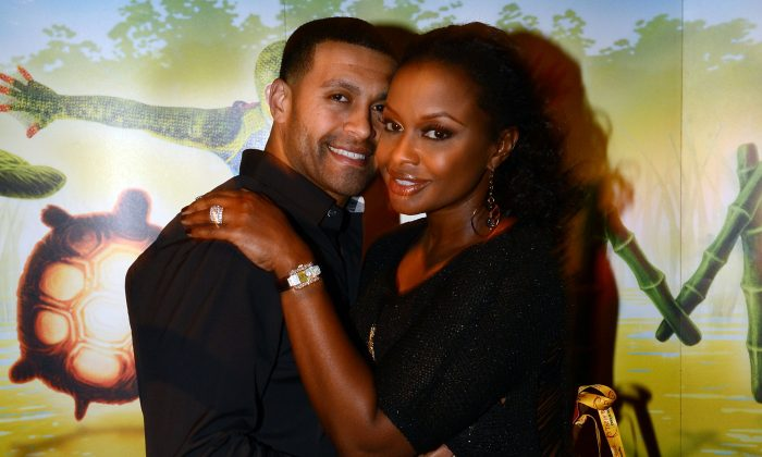 'Real Housewives of Atlanta' cast member Phaedra Parks (right) and Apollo Nida attend Cirque du Soleil TOTEM Premiere at Atlantic Station on October 26, 2012 in Atlanta, Georgia. (Photo by Rick Diamond/Getty Images for Cirque du Soleil)