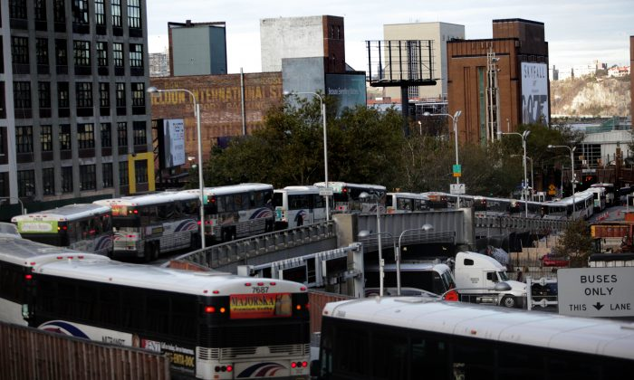 Busses drive into the Lincoln Tunnel from Port Authority Bus Terminal in New York City, Nov. 2, 2012. (Allison Joyce/Getty Images)