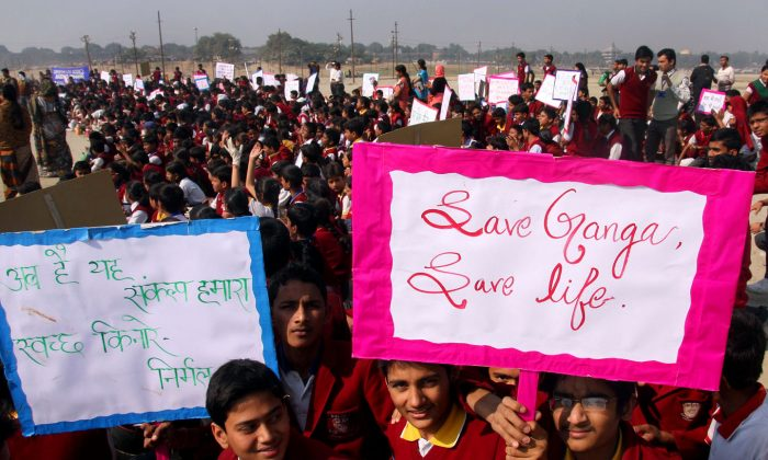 Indian school children hold placards during a rally protesting the pollution of the Ganga river on December 3, 2012. After spending more than rupees 5,000 crore ($806.192 million) over 28 years to clean Ganga river, the Indian Prime Minister's Office has finally directed the environment ministry to draft a legislation to protect and safeguard its free flow. (STR/AFP/Getty Images)