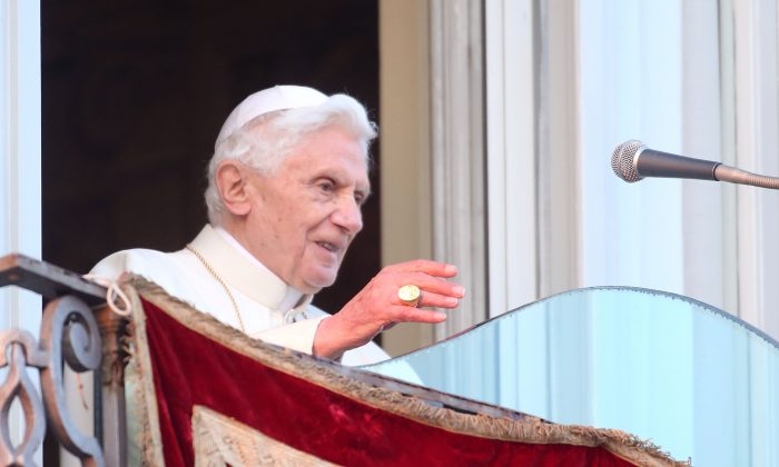 Pope Benedict XVI waves to pilgrims, for the last time as head of the Catholic Church, from the window of Castel Gandolfo on February 28, 2013 in Rome, Italy. (Franco Origlia/Getty Images)