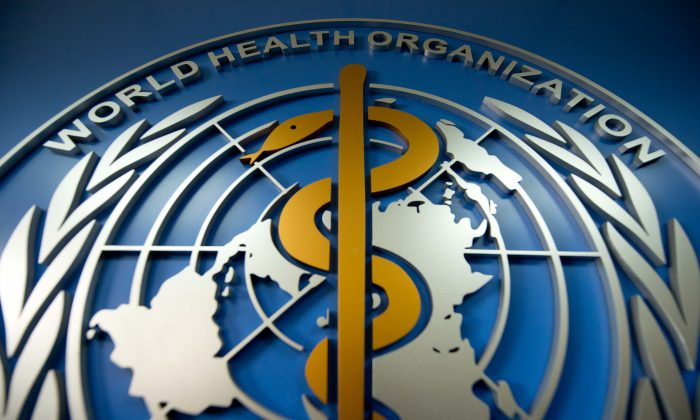 A World Health Organisation (WHO) logo is displayed at its office in Beijing on April 19, 2013. The agency's new World Cancer Report recorded over 3 million new cases of cancer in China of 14 million registered globally in 2012. (Ed Jones/AFP/Getty Images)