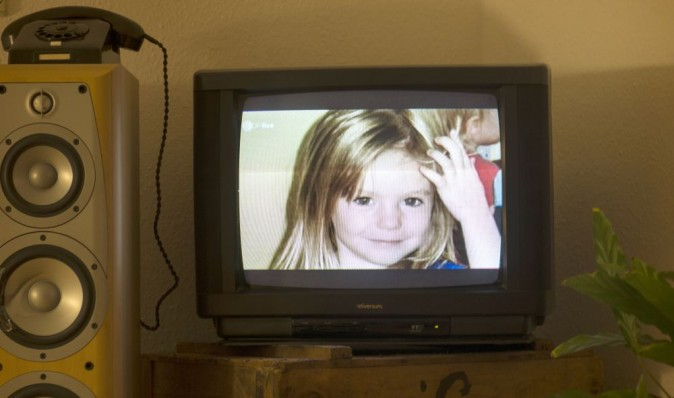 A photo of British girl Madeleine McCann aka Maddie is displayed on a TV screen at an apartment in Berlin, on October 16, 2013. (AFP)