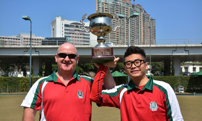 Noel Kennedy (Left) and Ken Chan proudly display the National Pairs trophy they won last Sunday, Feb 23, 2014, after defeating Marshall To and David Tso from Craigengower Cricket Club. This is the second National Pairs they have won together. (Stephanie Worth)