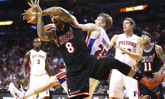 Lakers rumors: The Los Angeles Lakers could still be looking at the prospect of signing forward Michael Beasley. Miami Heat's Michael Beasley (8) and Detroit Pistons' Kyle Singler (25) fight for control of the ball during the first half of a NBA basketball game in Miami, Monday, Feb. 3, 2014. (AP Photo/J Pat Carter)