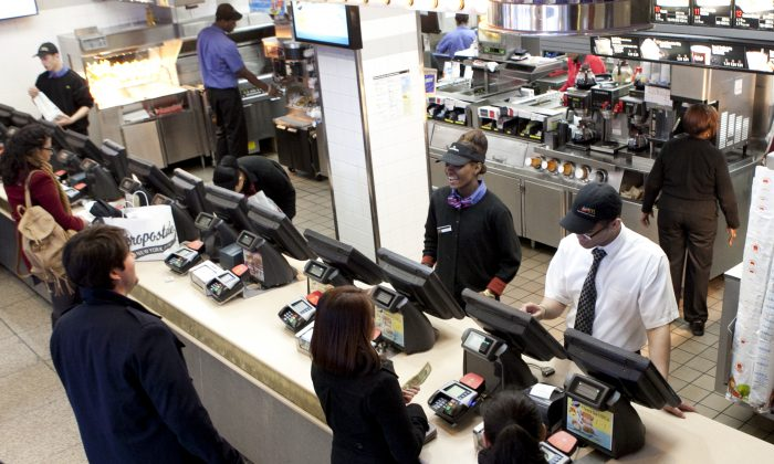 Workers at the McDonald's in Times Square, New York, on Feb. 13, 2013. (Samira Bouaou/Epoch Times)