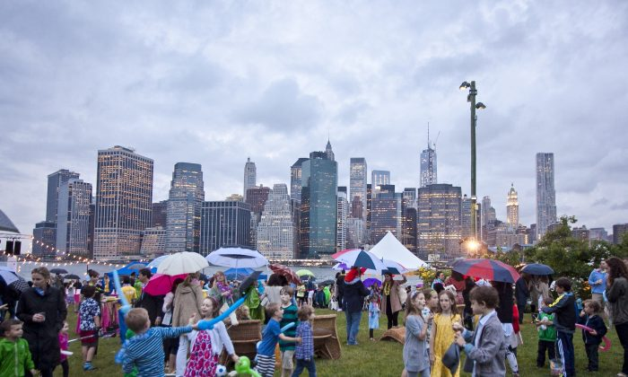 People enjoy the Sunset Ohana event at the Brooklyn Bridge Park on June 6, 2013. (Samira Bouaou/Epoch Times)