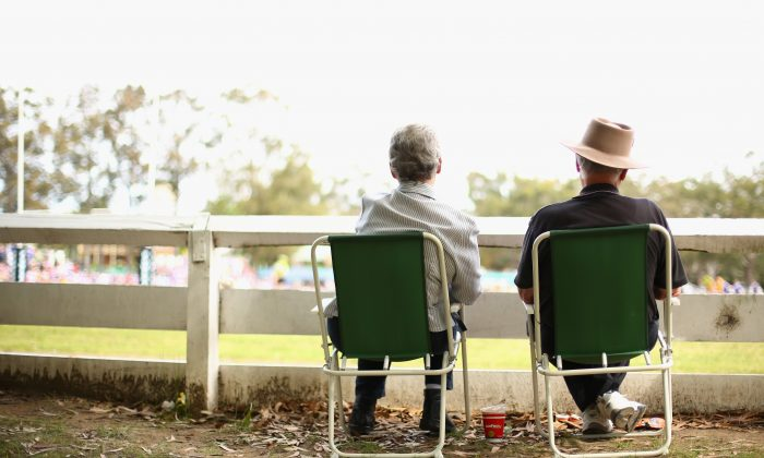 A retired couple watches a rugby match together. Most Canadians will not save for a particular target amount for retirement and then live the lifestyle that sum will afford them. More realistically, they will save as much as they can, while fixing the roof, buying a new car, and paying for children's post-secondary education. (Mark Kolbe/Getty Images)