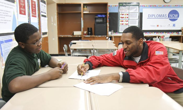 Xaundrae Tingling, a City Year corps member, tutors Daron Sanders at MS 126 in Brooklyn on Jan. 14, 2014. (Amelia Pang/Epoch Times)