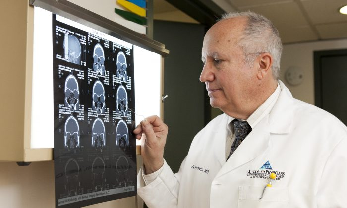 Dr. Allan Levin looks at a CT scan of a patient's sinuses. CT scans help him diagnose whether a patient has sinusitis and decide if surgery is needed. (Samira Bouaou/Epoch Times)