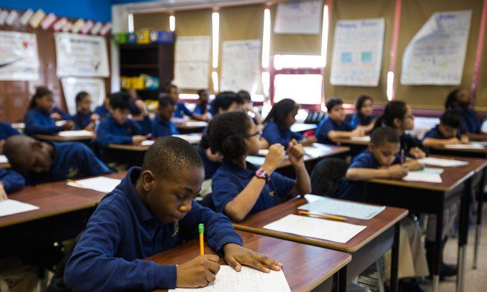 Fifth grade students during their homeroom class at Achievement First Bushwick charter school in Brooklyn, New York, Jan 30, 2014. (Petr Svab/Epoch Times)