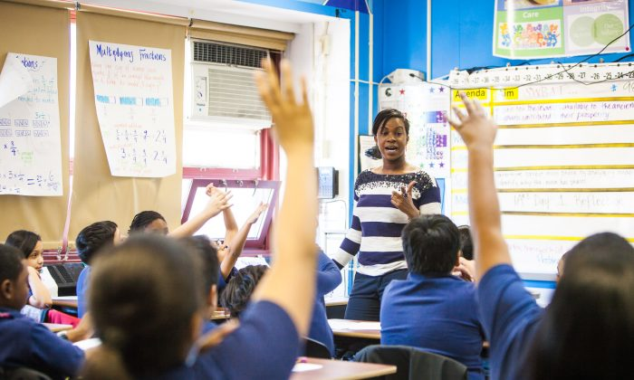 A fifth-grade teacher leading a homeroom class at Achievement First Bushwick charter school in Brooklyn, New York, Jan 30, 2014. New York state is struggling to hire more minority teachers, but they keep on leaving the profession. (Petr Svab/Epoch Times)