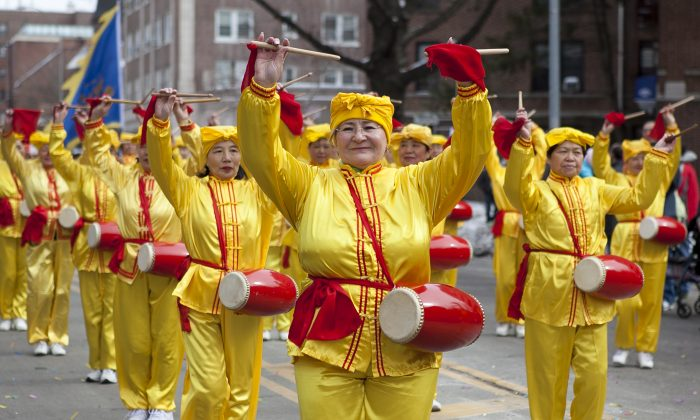 Drummers march in the Falun Dafa section of the Lunar New Year Parade in Flushing, New York, on Feb. 8, 2014. (Samira Bouaou/Epoch Times)