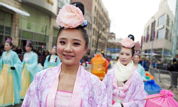 Young women dressed in traditional Chinese gowns walk in the Lunar New Year Parade  in Flushing, New York, on Feb. 8, 2014. (Samira Bouaou/Epoch Times)