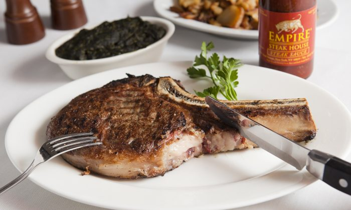 Ribeye steak with creamed spinach and German potatoes at Empire Steak House. (Samira Bouaou/Epoch Times)