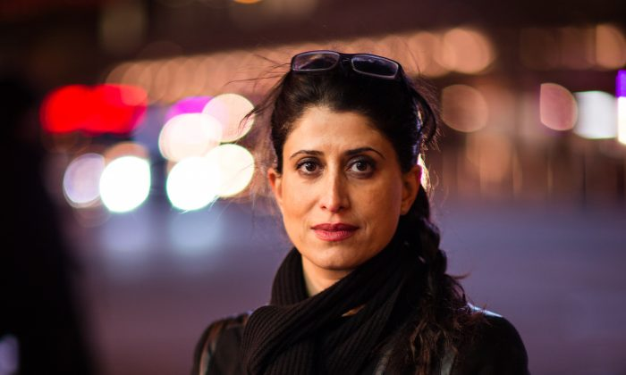 Sahar Khoshakhlagh on 8th Avenue near Times Square, New York, on Feb. 12, 2014. Khoshakhlagh took cover there after a police shooting on Sept. 14, 2013, that left her and another bystander wounded.  (Edward Dai/Epoch Times)