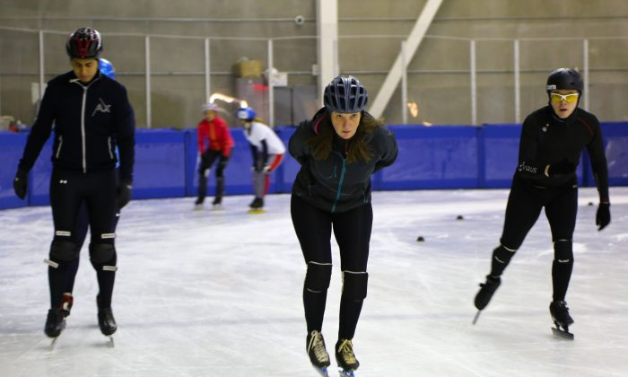 Joy Weber (C) participates in speedskating practice for the first time at the Flushing Meadows Aquatic Center and World Ice Arena, Feb. 17, 2014. Weber was inspired to try the sport for the first time after watching the Winter Olympics. (Ivan Pentchoukov/Epoch Times)