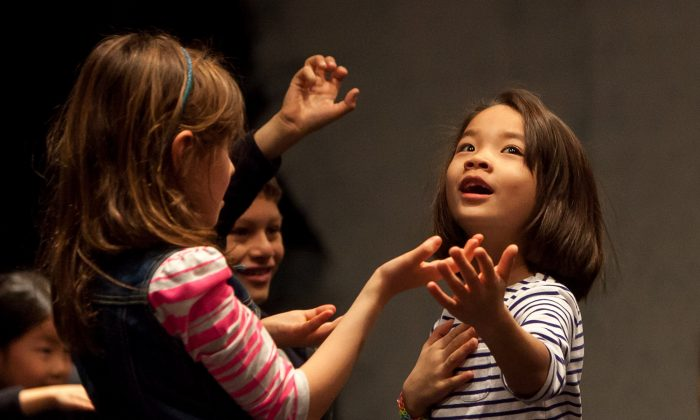 Children act at the Tada! Theater Winter Camp in Midtown Manhattan, New York, Feb. 17, 2014. (Petr Svab/Epoch Times)